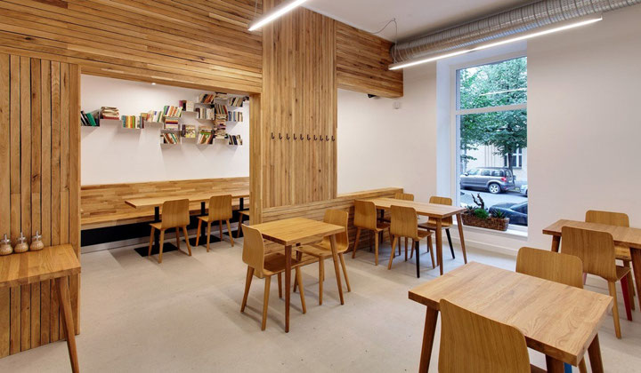 Wood table and chairs by TON, commercial cafeteria