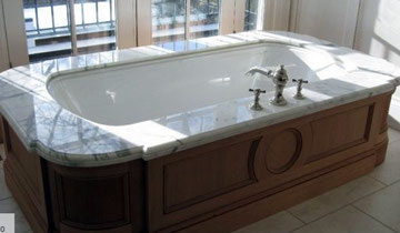 Bathtub edged with white marble