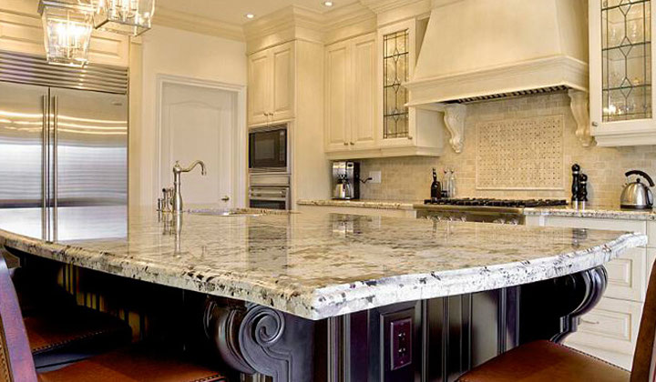 Traditional white kitchen with granite countertop by GT Kitchen & Bath, St. Catherines