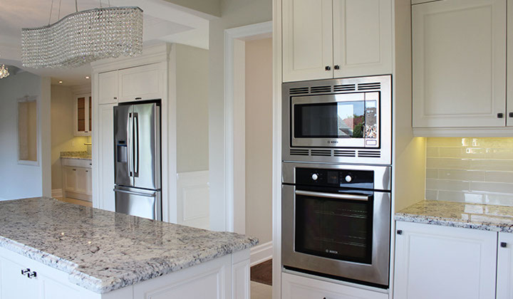 Shutter style white kitchen, custom fitted by Joseph Kitchens
