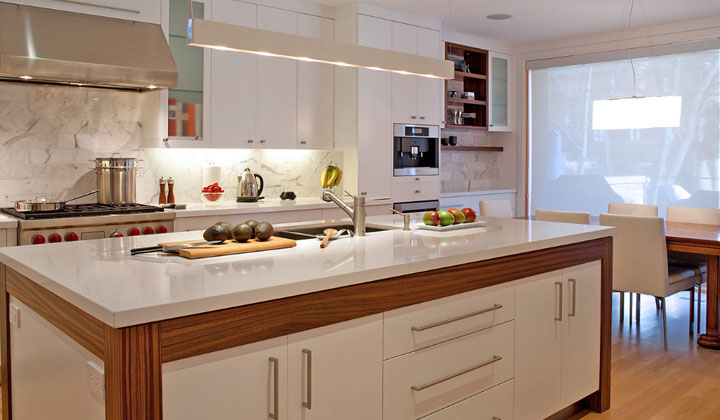 White modern kitchen with wooden accents by Chooka Kitchens