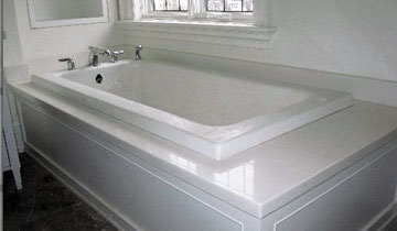 Bathtub edged with white marble , Toronto