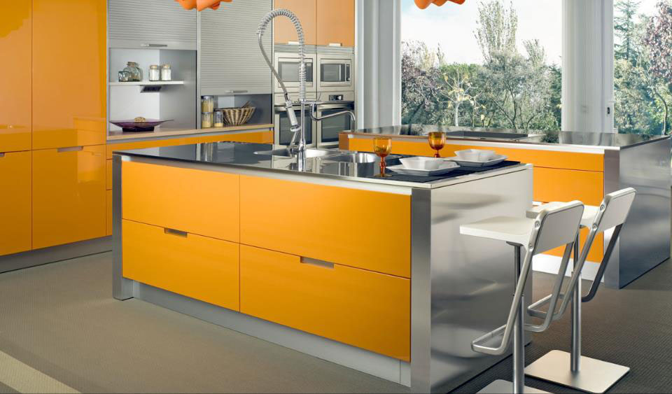Modern orange kitchen with stainless steel accents by Rimaco Interiors