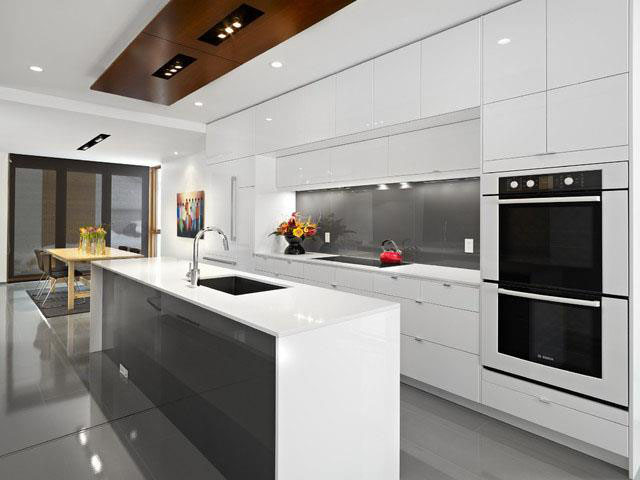 Modern glossy wite kitchen by Rimaco Interiors , GTA