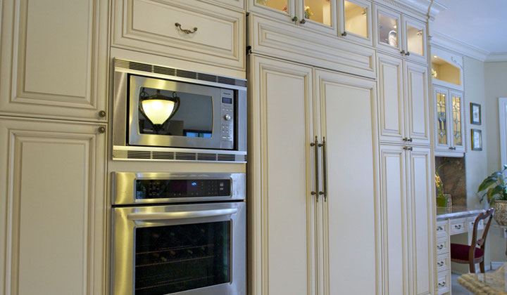 Shutter Style champagne color kitchen cabinets by Royal Classic Kitchens