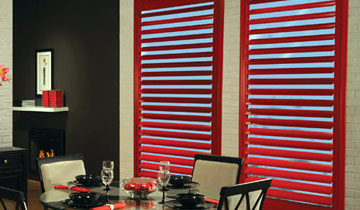 Red modern looking window shuters by Amazing window fashions, Toronto