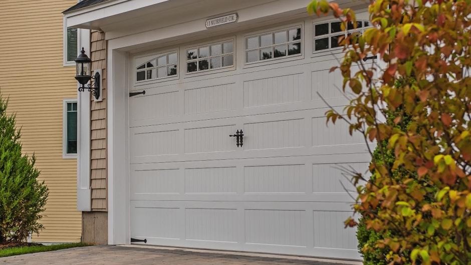 Foam-injected residential garage door, model 5916 with decorative hardware, B.J. Electric
