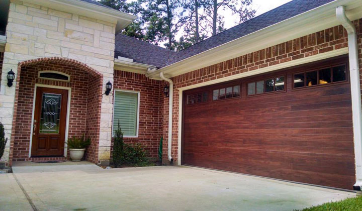 Foam-injected residential garage door, model 3216 in accent planks Mahogany, B.J. Electric