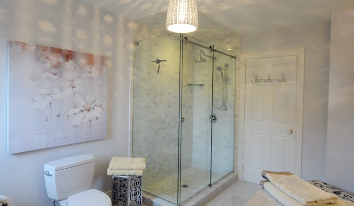 Glass shower with sliding doors, modern bathroom