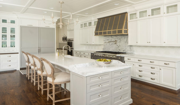 Luxury Kitchen with Glass cabinets and Custom Hood