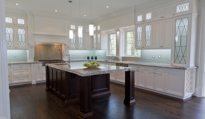 High End Transitional Kitchen with Metal Mullion Pattern on a glass cabinet door