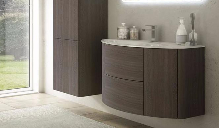 Curved shape vanity with round sides and drawers with matt and essences of wood finishes