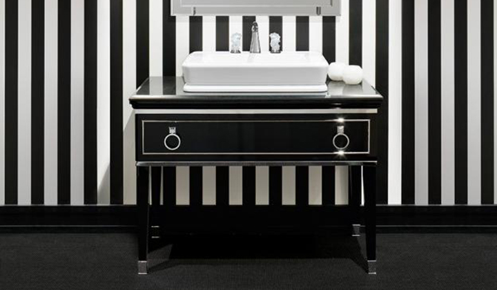 Vintage black bath vanity, cabinet and unit are characterized by refined and decorative door and drawer.
