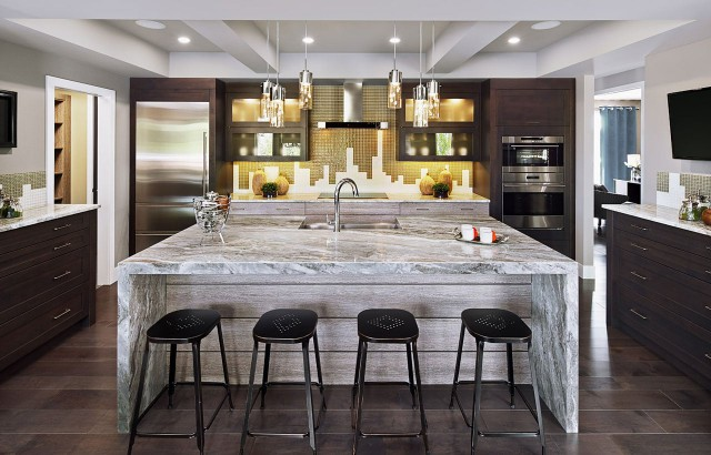 Transitional Kitchen with massive Waterfall Island