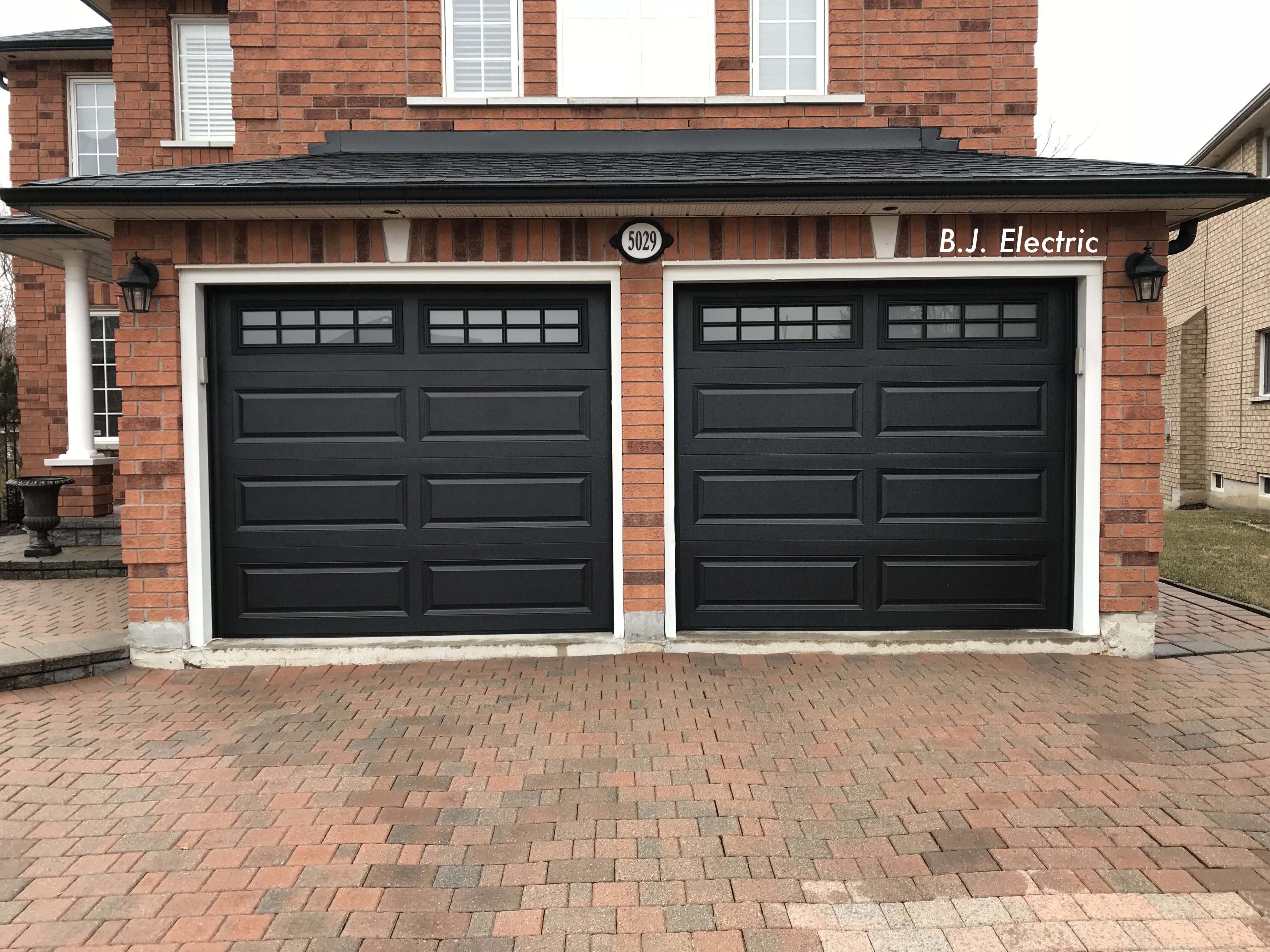 Foam-injected residential garage doors, model 4216 with frosted windows, B.J. Electric