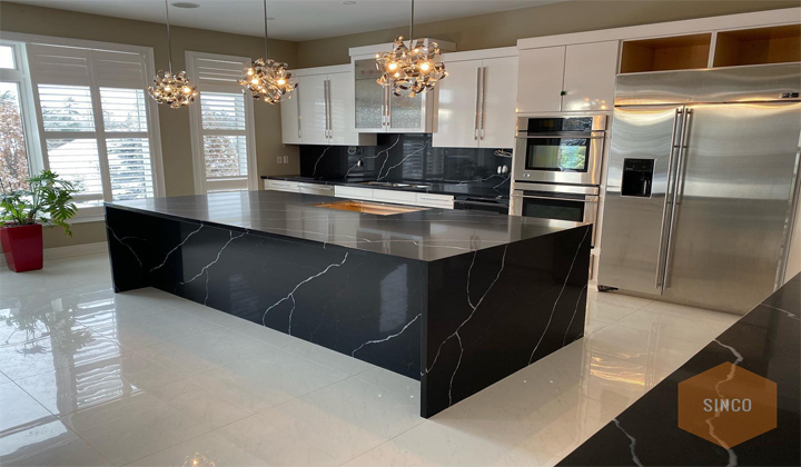 Quartz Midnight Marquina full slab island with waterfalls and front facia to compliment matching counters and full backsplash. Toronto.