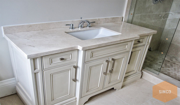 Italian Botticino marble vanity top by Sinco Marble & Granite. Toronto.